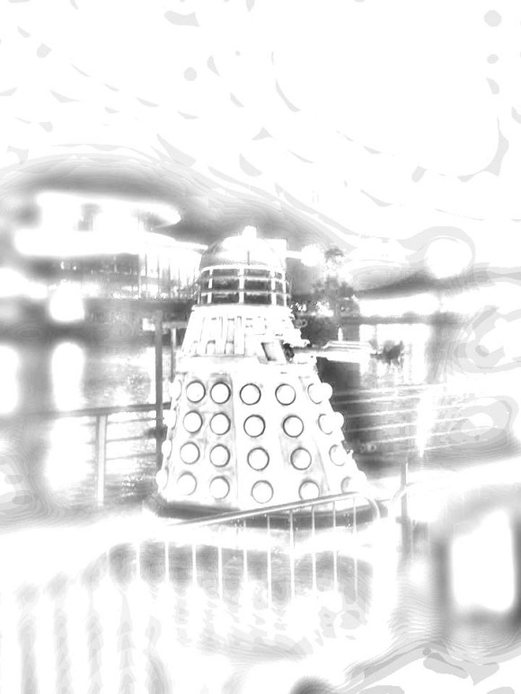 A Dalek from doctor who on the side of the trafford side of the quays....sans color....in black and white