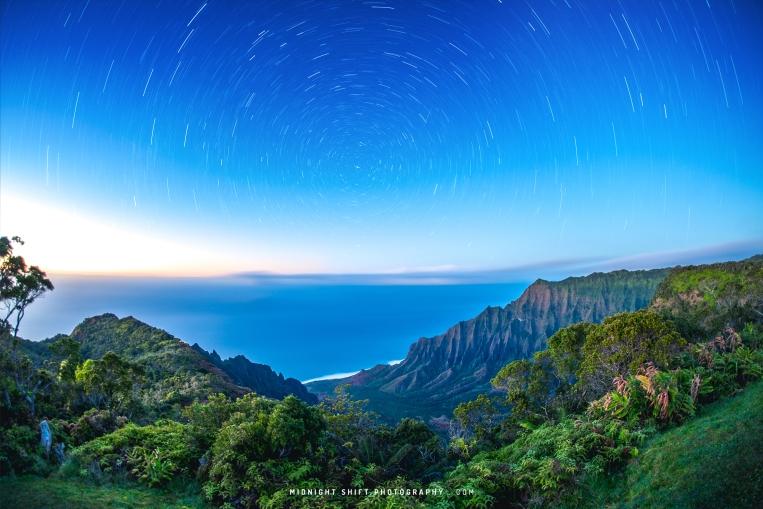 A photo of Stars trails captured at Kalalau Lookout on the island of Kauai, Hawaii.