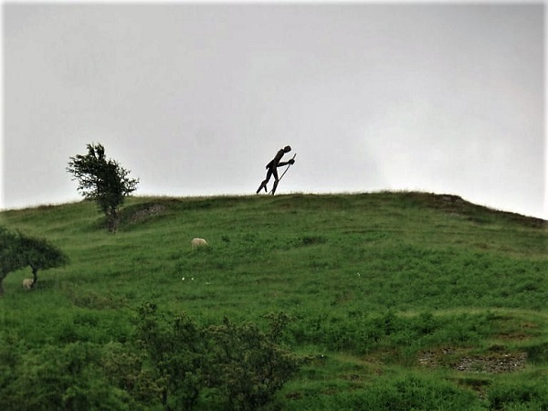 A Walker on a hill.