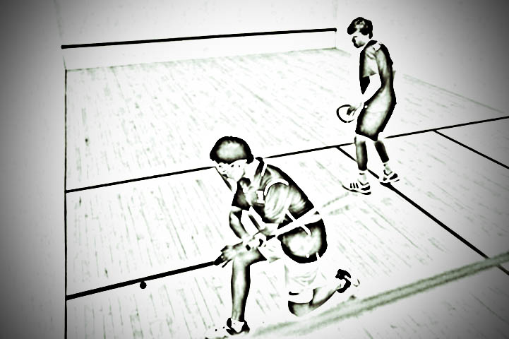 The game of Squash, two players hitting the ball against the wall with the sender of the ball trying to pass the reciever