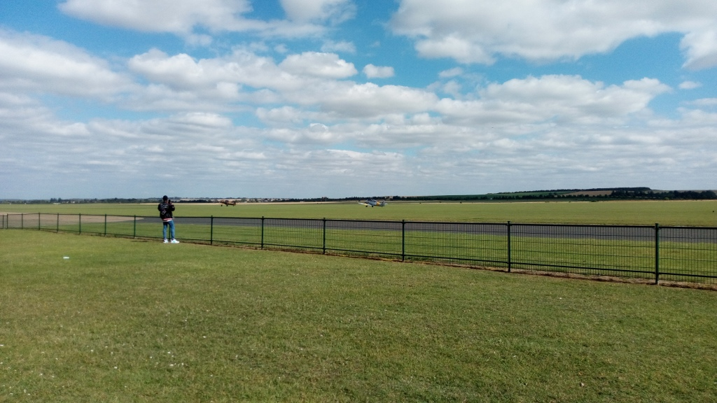 A shot of Duxford Airfield, Taken by Inky, for the planes taking off and the clouds in the horizon
